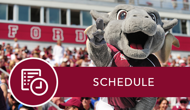 The Fordham Ram mascot in front of crowded bleachers on Jack Coffey field and the link to the Homecoming Schedule.