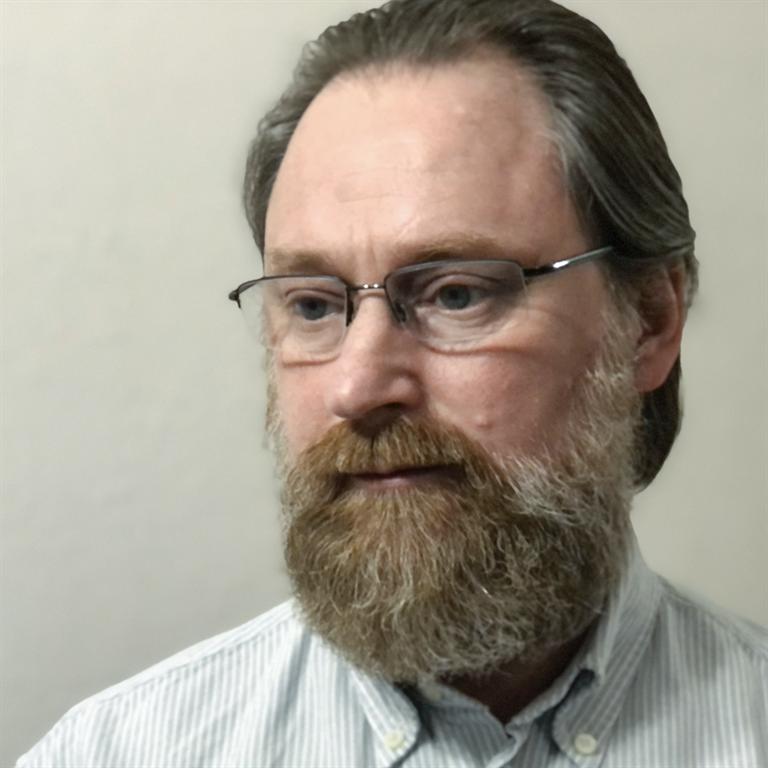 headshot of Sergei Chapnin