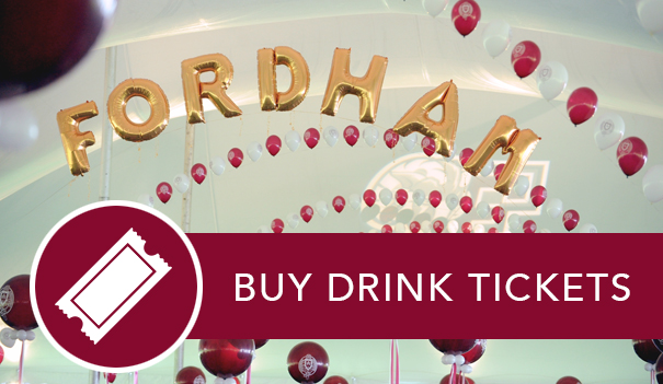 Giant Fordham balloons under the Homecoming tent and the link to pre-purchase drink tickets.