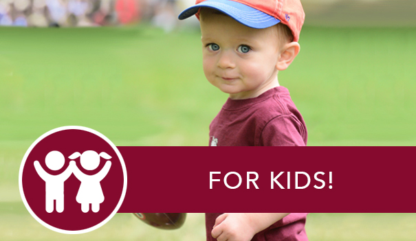 A young child in a baseball hat and a Fordham t-shirt and the link to learn more about kids' activities at Homecoming.